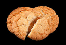 Cracked biscuit on black Stock Image
