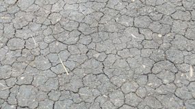 Cracked in Black Dry Soil Ground Background Texture Royalty Free Stock Photo