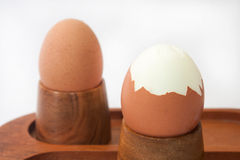 Cracked boiled egg on the wooden holder Stock Image