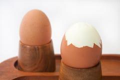 Cracked boiled egg on the wooden holder Stock Image