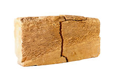Cracked brick. The simple brick with a large crack,  on white Stock Image