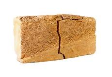 Cracked brick. Stock Image