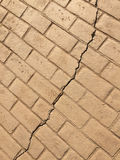 Cracked brick road. There is a crack on brick road Stock Photo