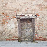 Cracked brick wall with bricked up doorway Stock Images