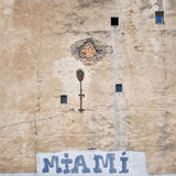Cracked brick wall with graffiti Royalty Free Stock Photo