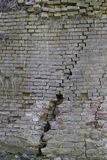 Cracked brick wall. Old cracked brick wall at the foot of the fortress Royalty Free Stock Images