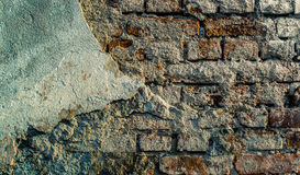 Cracked Brick Wall. Texture with weathered whitewashed area in the left side Royalty Free Stock Photography