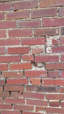 Cracked and Broken Brick Wall Stock Image