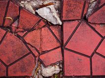 Cracked red clay geometric tile floor background Stock Photography
