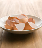 Cracked Brown egg shells. In a white bowl Stock Photos
