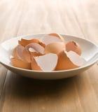 Cracked Brown egg shells Stock Photos