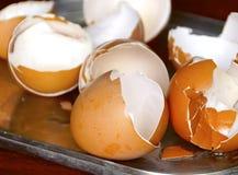 Cracked brown eggshell Stock Photo