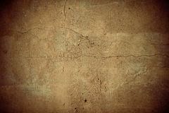 Cracked brown vignette concrete wall Stock Photography