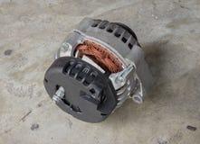 Cracked car alternator stock images