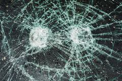 Cracked car window. Vandalism effect. The broken windshield of the car Stock Images