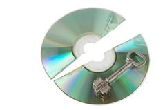Cracked Cd with key Stock Photo