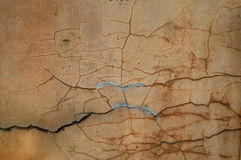 Cracked cement/stucco wall texture. A heavily damaged and cracked exterior wall Royalty Free Stock Photography