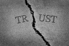 Cracked cement symbolizing broken trust between people or parties stock images