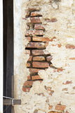 Cracked Cement Wall with Orange Brick Inside Stock Images