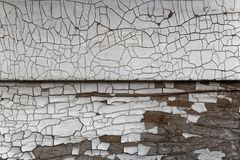 Cracked and chipped paint on a house. The cracked and chipped paint on the siding of a house royalty free stock images