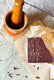 Cracked chocolate bar with spices Royalty Free Stock Photography