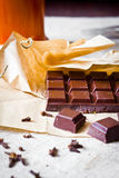 Cracked chocolate bar with spices Stock Photos