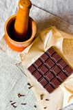 Cracked chocolate bar with spices Royalty Free Stock Photo