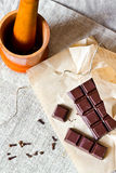 Cracked chocolate bar with spices Stock Photo