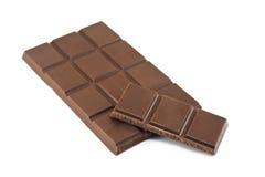 Cracked chocolate bars. Cracked milk chocolate bars on white background Stock Image