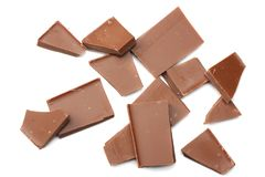 Cracked chocolate candies sweets isolated on white background top view Stock Photos