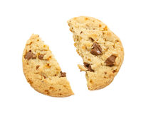 Cracked chocolate chip cookie on white background Royalty Free Stock Images