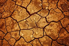 A background image of dried and cracked soil stock photography
