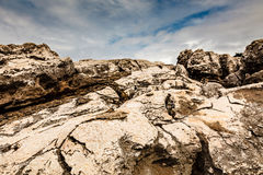 Cracked Cliffs on Rocky Beach in Cascais near Lisbon Stock Image