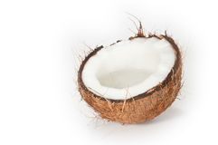 A cracked coconut on white background Royalty Free Stock Photo