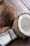Cracked Coconut on wood Stock Image