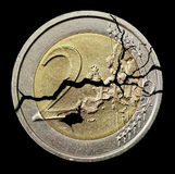 Cracked coin Stock Images