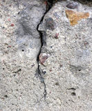 Cracked concrete. Monolith. Stones visible Stock Photos
