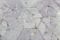 Cracked Concrete Hexagon Paver Bricks on Walkway stock image
