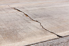 Cracked concrete road Stock Photo