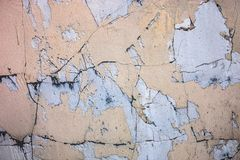 Cracked concrete surface with the remains of sandy-tan paint Stock Photo