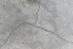 Cracked concrete wall surface of rough texture background stock photography