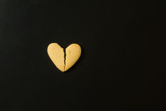 Cracked cookie in a heart shape. Broken heart concept royalty free stock photography