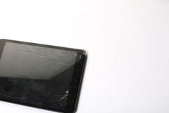 Cracked tablet screen. Cracked and damaged tablet screen royalty free stock photography