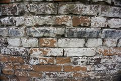 Cracked Dark Red Old Brick Wall Texture. Damaged Brown Abstract Blank Stonewall Background. Ruinous Brickwall Dilapidation. / stock photo