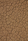 Cracked desert background texture Stock Photos