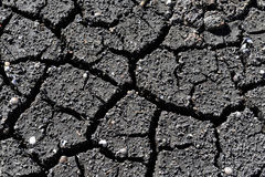 Cracked Dirt. Cracked black dirt in Hawaii Royalty Free Stock Photography