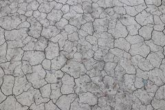 The cracked, dried earth is gray. A desert without water. Arid ground. Thirst for moisture on a lifeless space. Ecological situati. On in the world. Saving water stock photos