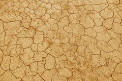The cracked, dried earth is yellow. A desert without water. Arid ground. Thirst for moisture on a lifeless space. Ecological situa. Tion in the world. Saving stock photo