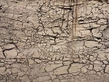 Cracked. The dry texture of the land fragmented, metaphor for the longing of peace, drought is a natural disaster, irrational real estate development will evolve royalty free stock images