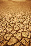 Cracked earth background. Cracked and dried mud texture royalty free stock image